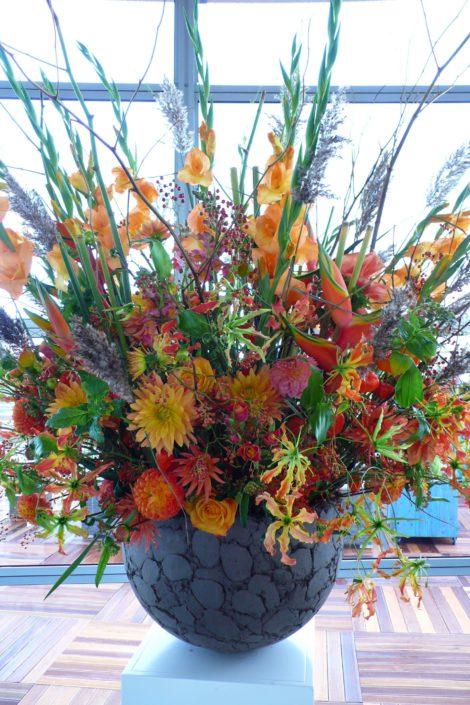 decoratie KLM Open herfstbloemen in oranje tinten